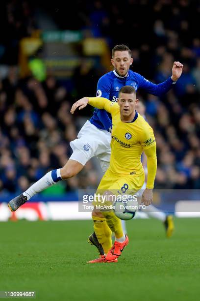 Gylfi Sigurdsson of Everton challenges for the ball with Ross Barkley during the Premier League match between Everton and Chelsea at Goodison Park on...