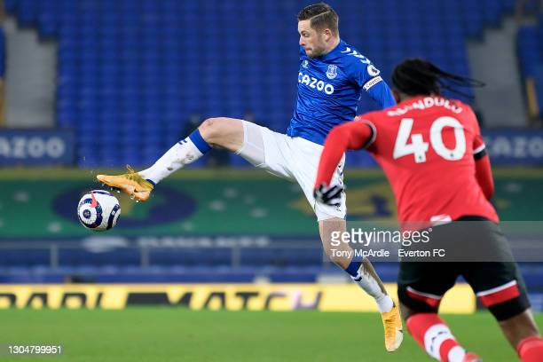 Gylfi Sigurdsson of Everton controls the ball during the Premier League match between Everton and Southampton at Goodison Park on March 2021 in...