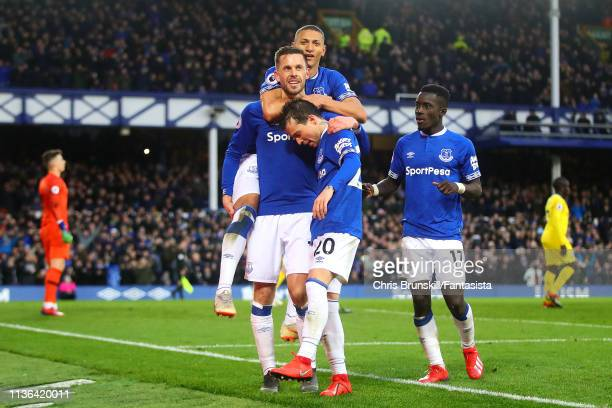 Gylfi Sigurdsson of Everton FC is congratulated by his teammates after scoring his side's second goal during the Premier League match between Everton...