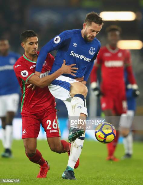 Gylfi Sigurdsson of Everton holds off Kyle Naughton of Swansea City during the Premier League match between Everton and Swansea City at Goodison Park...