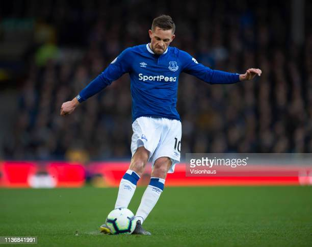 Gylfi Sigurdsson of Everton in action during the Premier League match between Everton FC and Chelsea FC at Goodison Park on March 17 2019 in...