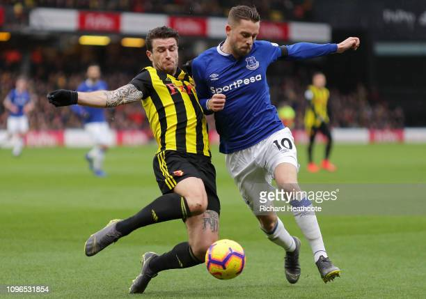 Gylfi Sigurdsson of Everton is challenged by Daryl Janmaat of Watford during the Premier League match between Watford FC and Everton FC at Vicarage...