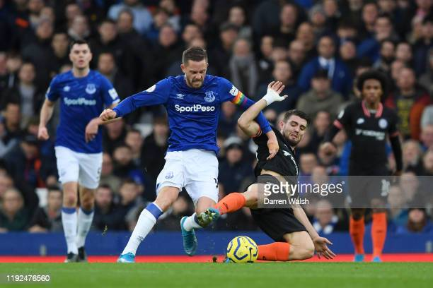 Gylfi Sigurdsson of Everton is challenged by Mateo Kovacic of Chelsea during the Premier League match between Everton FC and Chelsea FC at Goodison...