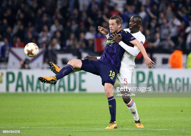 Gylfi Sigurdsson of Everton Mouctar Diakhaby of Lyon during the UEFA Europa League group E match between Olympique Lyonnais and Everton FC at...