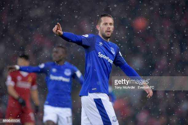 Gylfi Sigurdsson of Everton prepares to take a corner during the Premier League match between Liverpool and Everton at Anfield on December 10 2017 in...