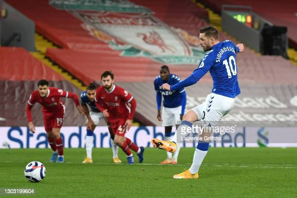 Gylfi Sigurdsson of Everton scores a penalty for his team's second goal during the Premier League match between Liverpool and Everton at Anfield on...