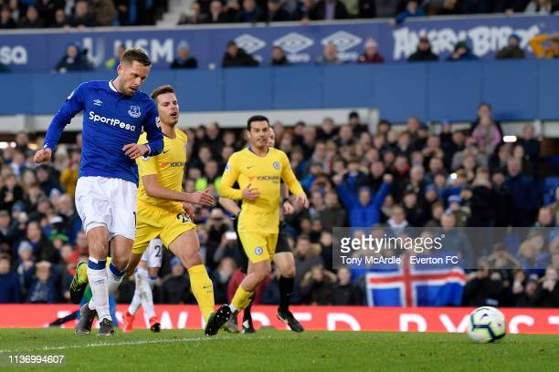 Gylfi Sigurdsson of Everton scores during the Premier League match between Everton and Chelsea at Goodison Park on March 17 2019 in Liverpool England