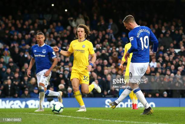 Gylfi Sigurdsson of Everton scores his sides second goal during the Premier League match between Everton FC and Chelsea FC at Goodison Park on March...