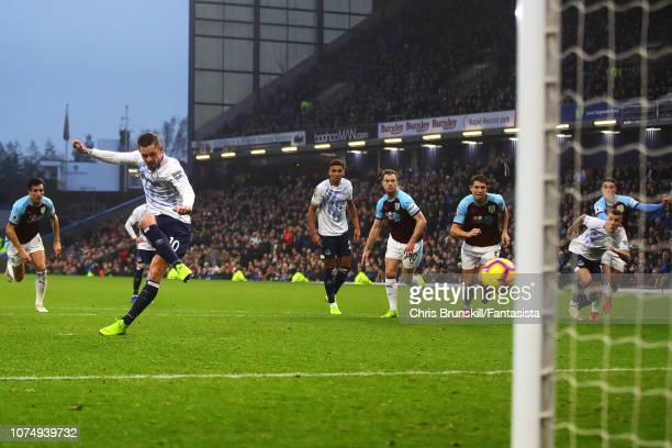 Gylfi Sigurdsson of Everton scores his side's third goal from the penalty spot during the Premier League match between Burnley FC and Everton FC at...