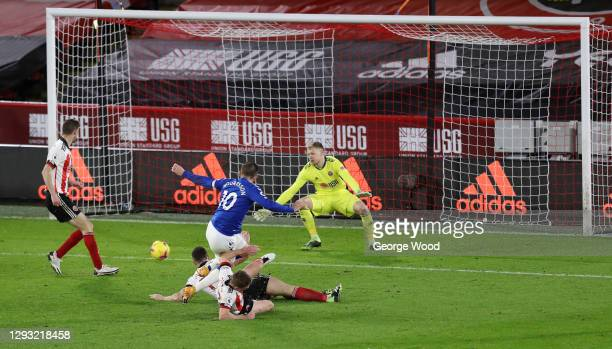 Gylfi Sigurdsson of Everton scores his team's first goal past Aaron Ramsdale of Sheffield United during the Premier League match between Sheffield...