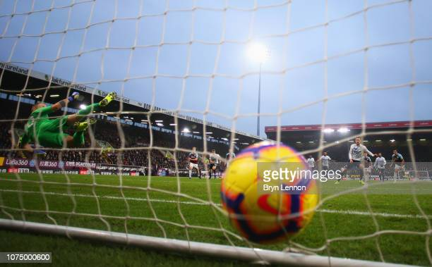 Gylfi Sigurdsson of Everton scores his team's third goal from a penalty past Joe Hart of Burnley during the Premier League match between Burnley FC...