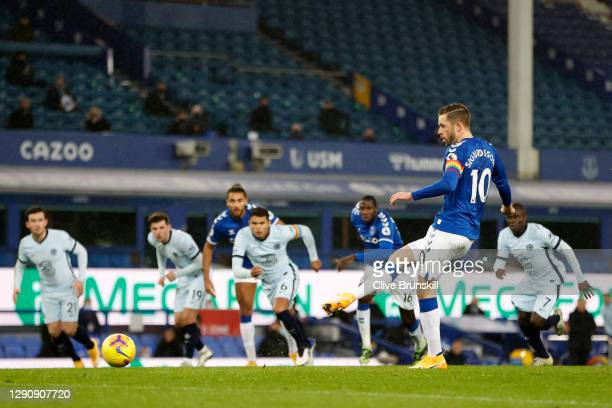 Gylfi Sigurdsson of Everton scores their team's first goal from the penalty spot during the Premier League match between Everton and Chelsea at...