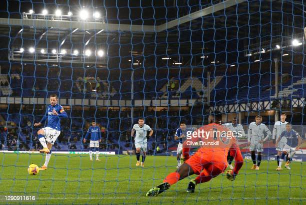 Gylfi Sigurdsson of Everton scores their team's first goal from the penalty spot past Edouard Mendy of Chelsea during the Premier League match...