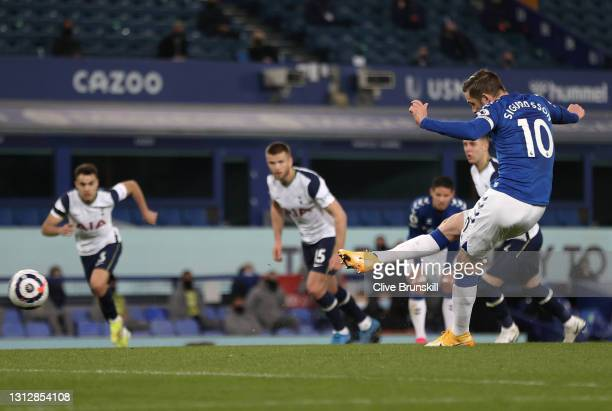 Gylfi Sigurdsson of Everton scores their team's first goal from the penalty spot during the Premier League match between Everton and Tottenham...