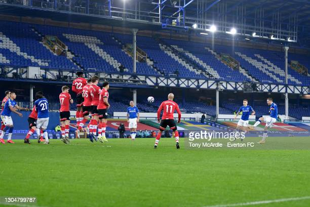 Gylfi Sigurdsson of Everton takes a free kick during the Premier League match between Everton and Southampton at Goodison Park on March 2021 in...