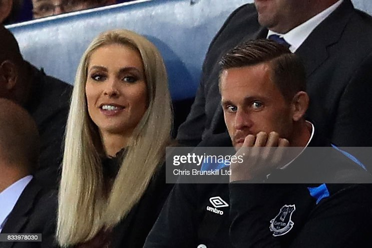 Gylfi Sigurdsson of Everton watches the match with partner Alexandra Ivarsdottir during the UEFA Europa League Qualifying Play-Offs round first leg match between Everton FC and Hajduk Split at Goodison Park on August 17, 2017 in Liverpool, United Kingdom.