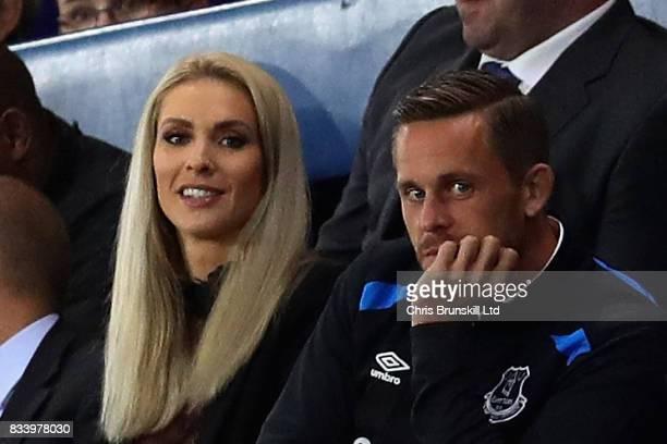 Gylfi Sigurdsson of Everton watches the match with partner Alexandra Ivarsdottir during the UEFA Europa League Qualifying PlayOffs round first leg...