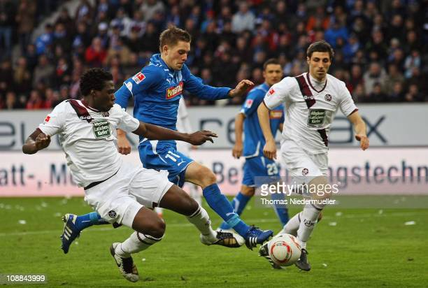 Gylfi Sigurdsson of Hoffenheim fights for the ball with Rodnei and Matthias Abel of Kaiserslautern during the Bundesliga match between 1899...