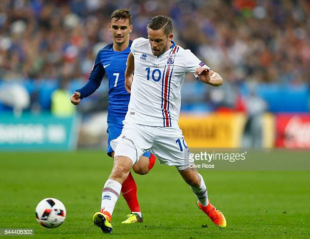 Gylfi Sigurdsson of Iceland and Antoine Griezmann of France compete for the ball during the UEFA EURO 2016 quarter final match between France and...