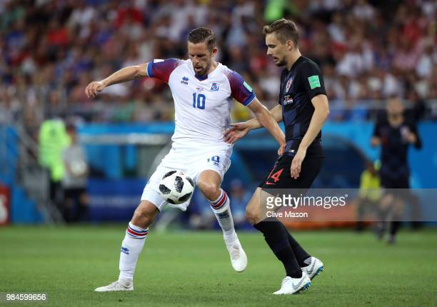 Gylfi Sigurdsson of Iceland and Filip Bradaric of Croatia in action during the 2018 FIFA World Cup Russia group D match between Iceland and Croatia...
