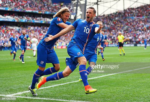 Gylfi Sigurdsson of Iceland celebrates with Birkir Bjarnason of Iceland scoring his team's first goal during the UEFA EURO 2016 Group F match between...