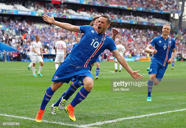 Gylfi Sigurdsson of Iceland celebrates with Birkir Bjarnason of Iceland after scoring his team's first goal during the UEFA EURO 2016 Group F match...