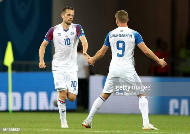 Gylfi Sigurdsson of Iceland celebrates with teammate Bjorn Sigurdarson after scoring a penalty for his team's first goal during the 2018 FIFA World...