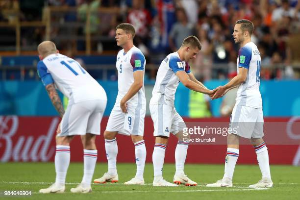 Gylfi Sigurdsson of Iceland consoles teammate Johann Gudmundsson of Iceland after their sides defeat in the 2018 FIFA World Cup Russia group D match...