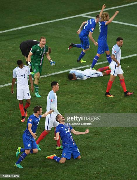 Gylfi Sigurdsson of Iceland falls to his knees in celebration as his team knock out England in the UEFA Euro 2016 Round of 16 match between England...