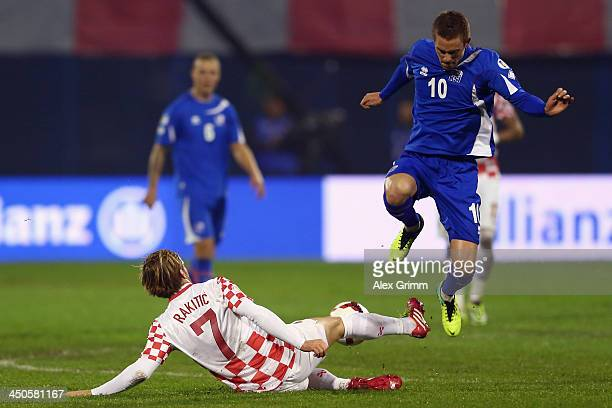 Gylfi Sigurdsson of Iceland is challenged by Ivan Rakitic of Croatia during the FIFA 2014 World Cup Qualifier playoff second leg match between...