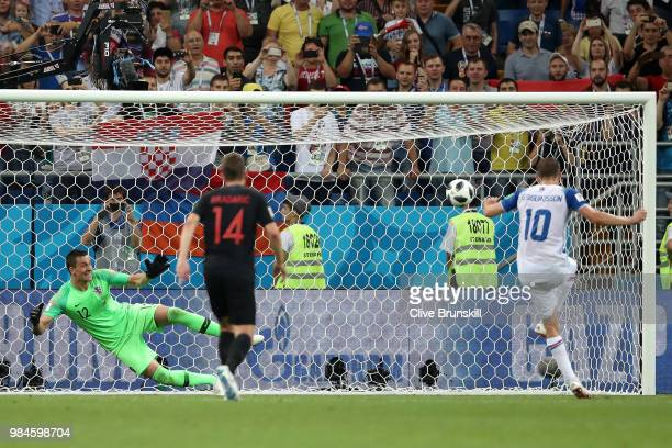 Gylfi Sigurdsson of Iceland scores a penalty for his team's first goal during the 2018 FIFA World Cup Russia group D match between Iceland and...