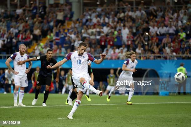 Gylfi Sigurdsson of Iceland scores his sides opening goal from a penalty to make the score 1-1 during the 2018 FIFA World Cup Russia group D match...