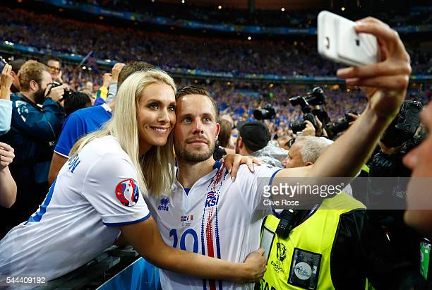 Gylfi Sigurdsson of Iceland takes a selfie photographs with his girlfriend Alexandra Ivarsdottir after the UEFA EURO 2016 quarter final match between...