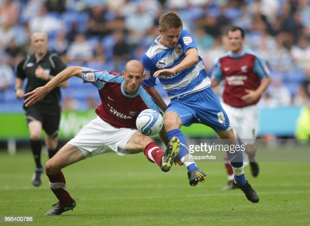 Gylfi Sigurdsson of Reading tangles with Rob Jones of Scunthorpe United during an Npower Championship match at the Madejski Stadium on August 7 2010...