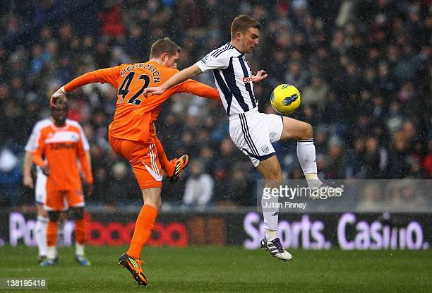 Gylfi Sigurdsson of Swansea battles with James Morrison of West Brom during the Barclays Premier League match between West Bromwich Albion and...