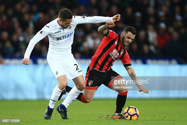Gylfi Sigurdsson of Swansea City and Jack Wilshere of AFC Bournemouth compete for the ball during the Premier League match between Swansea City and...
