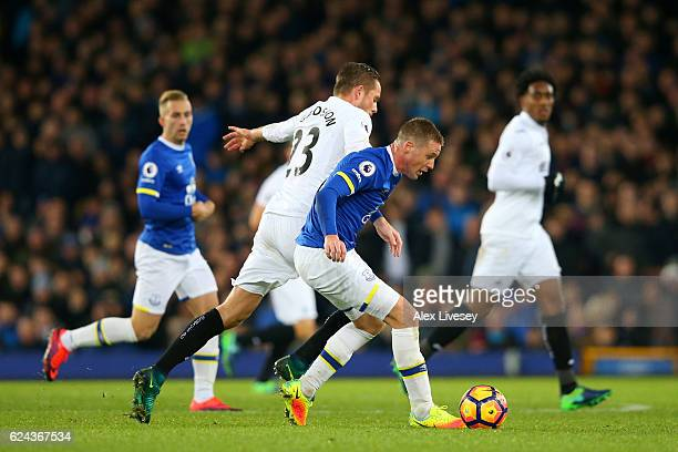Gylfi Sigurdsson of Swansea City and James McCarthy of Everton battle for possession during the Premier League match between Everton and Swansea City...