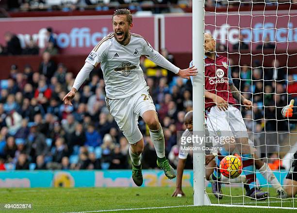 Gylfi Sigurdsson of Swansea City celebrates his team's second goal by Andre Ayew during the Barclays Premier League match between Aston Villa and...