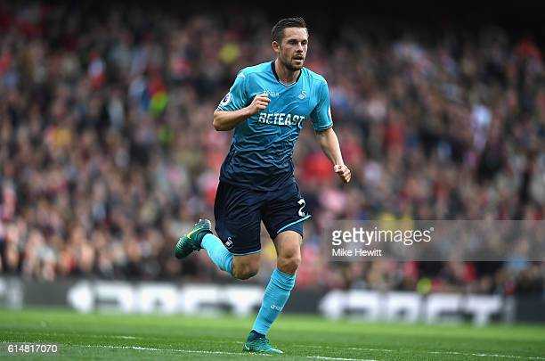 Gylfi Sigurdsson of Swansea City celebrates scoring his sides first goal during the Premier League match between Arsenal and Swansea City at Emirates...