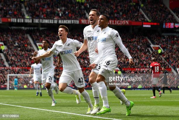 Gylfi Sigurdsson of Swansea City celebrates scoring his sides first goal with his Swansea City team mates during the Premier League match between...