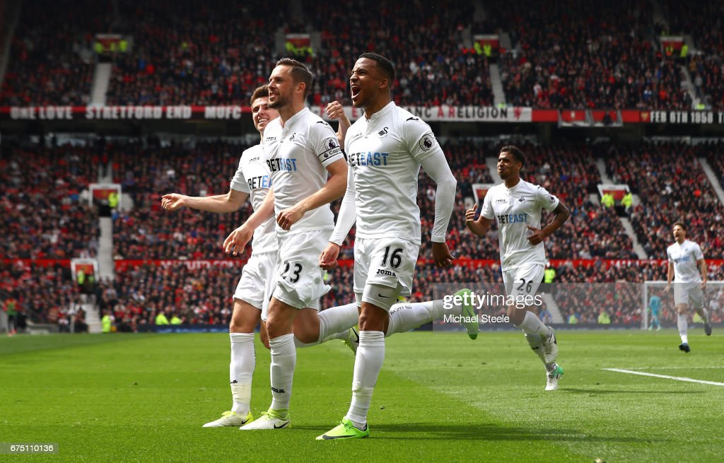 Gylfi Sigurdsson of Swansea City celebrates scoring his sides first goal with Martin Olsson of Swansea City during the Premier League match between Manchester United and Swansea City at Old Trafford on April 30, 2017 in Manchester, England.