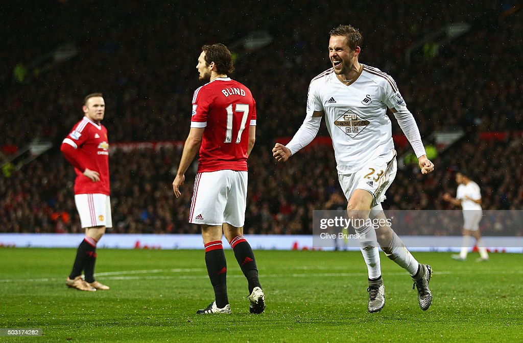 Gylfi Sigurdsson of Swansea City celebrates scoring his team's first goal during the Barclays Premier League match between Manchester United and Swansea City at Old Trafford on January 2, 2016 in Manchester, England.