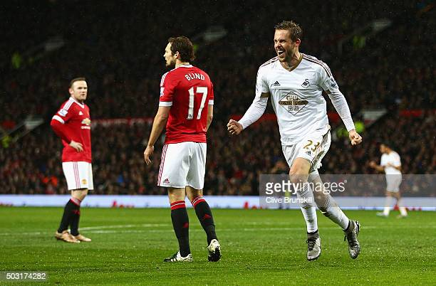 Gylfi Sigurdsson of Swansea City celebrates scoring his team's first goal during the Barclays Premier League match between Manchester United and...
