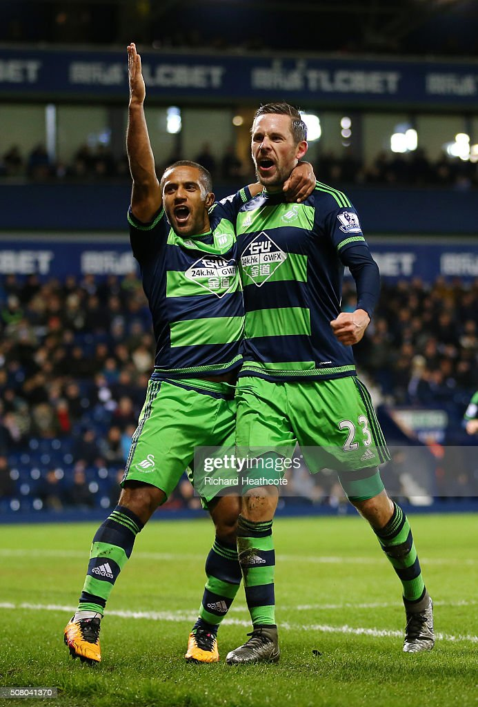 Gylfi Sigurdsson (R) of Swansea City celebrates scoring his team's first goal with his team mate Wayne Routledge (L) during the Barclays Premier League match between West Bromwich Albion and Swansea City at The Hawthorns on February 2, 2016 in West Bromwich, England.