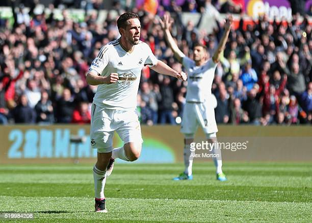 Gylfi Sigurdsson of Swansea City celebrates scoring his team's first goal during the Barclays Premier League match between Swansea City and Chelsea...