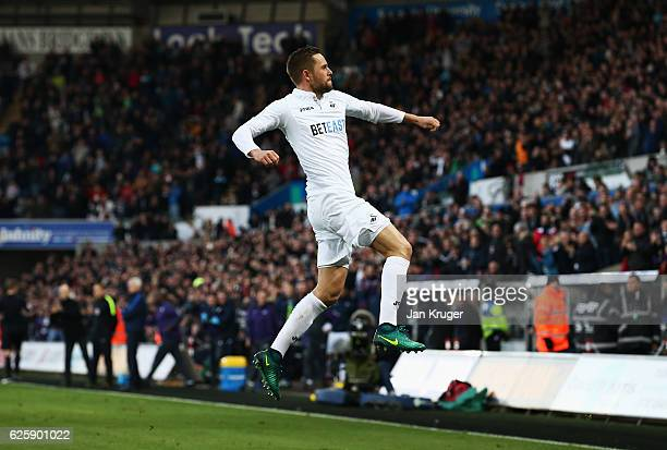 Gylfi Sigurdsson of Swansea City celebrates scoring his team's first goal during the Premier League match between Swansea City and Crystal Palace at...