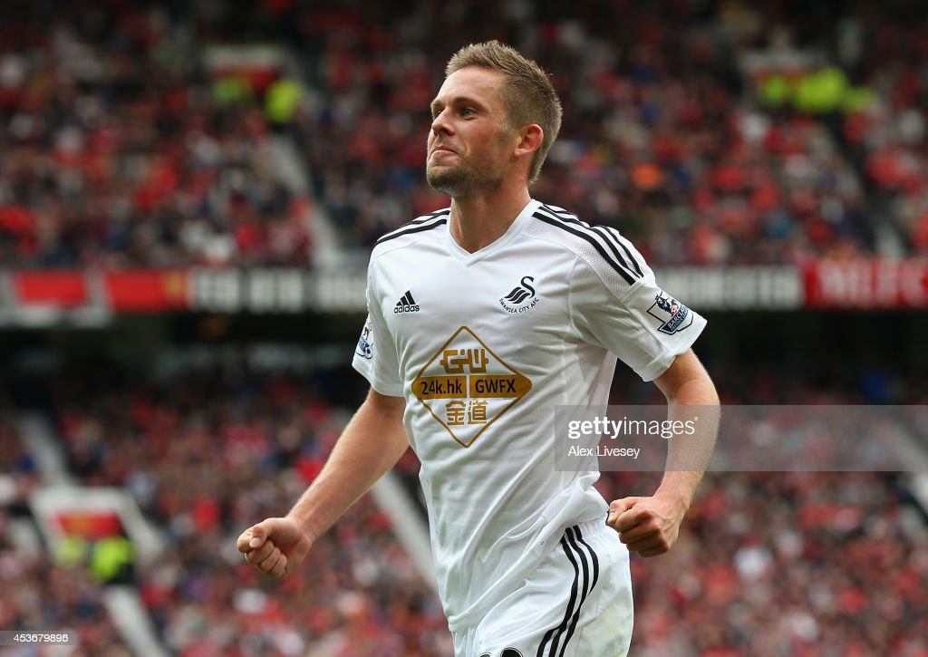 Gylfi Sigurdsson of Swansea City celebrates scoring his team's second goal during the Barclays Premier League match between Manchester United and Swansea City at Old Trafford on August 16, 2014 in Manchester, England.