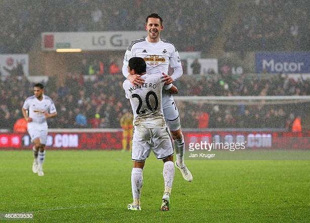 Gylfi Sigurdsson of Swansea City celebrates with Jefferson Montero as he scores their first goal during the Barclays Premier League match between...
