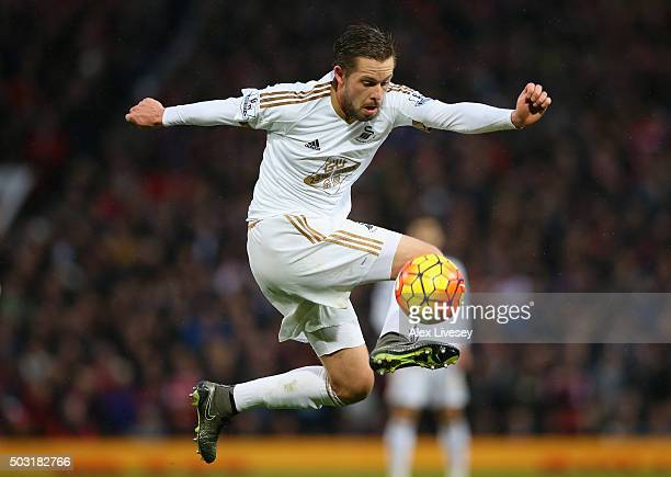 Gylfi Sigurdsson of Swansea City controls the ball during the Barclays Premier League match between Manchester United and Swansea City at Old...