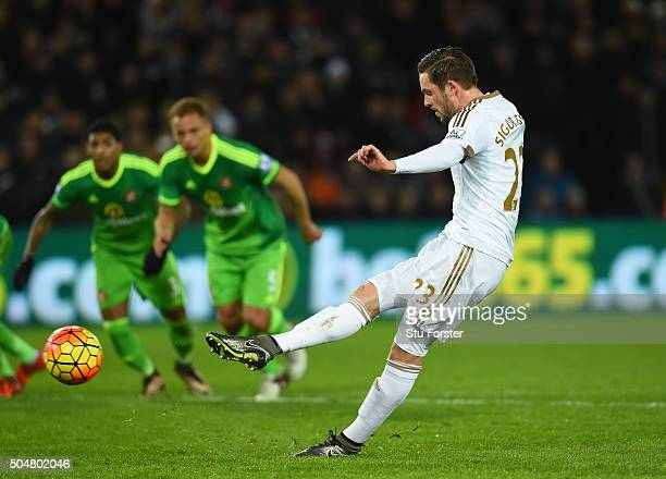 Gylfi Sigurdsson of Swansea City converts the penalty to score his team's first goal during the Barclays Premier League match between Swansea City...
